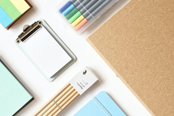 Pastel colored school supplies on a white table