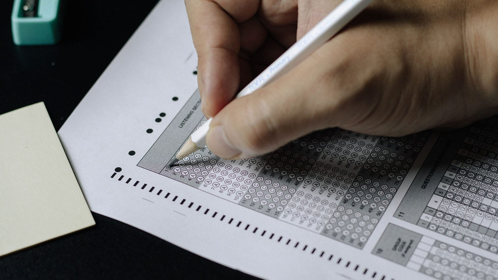 Student filling out test sheet