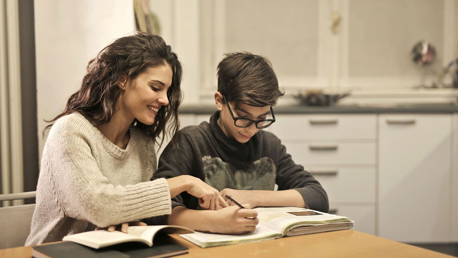 A teacher tutoring a student