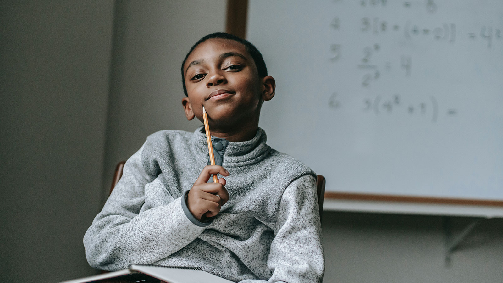 Thoughtful boy with pencil